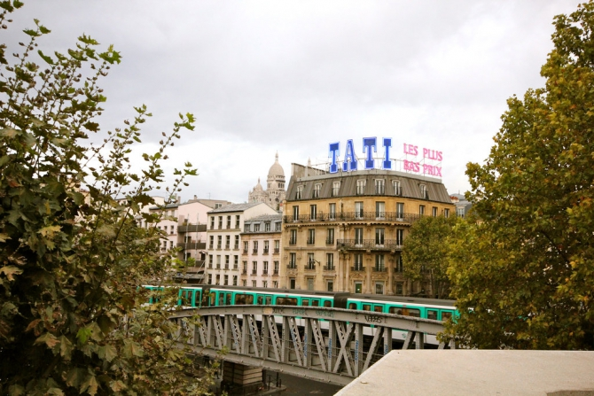 The balcony of the Louxor offers a view of the elevated No. 2 Métro train.